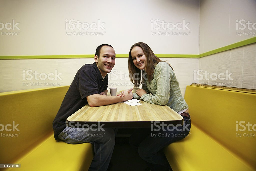 Caucasian Couple in a Donut Shop royalty-free stock photo