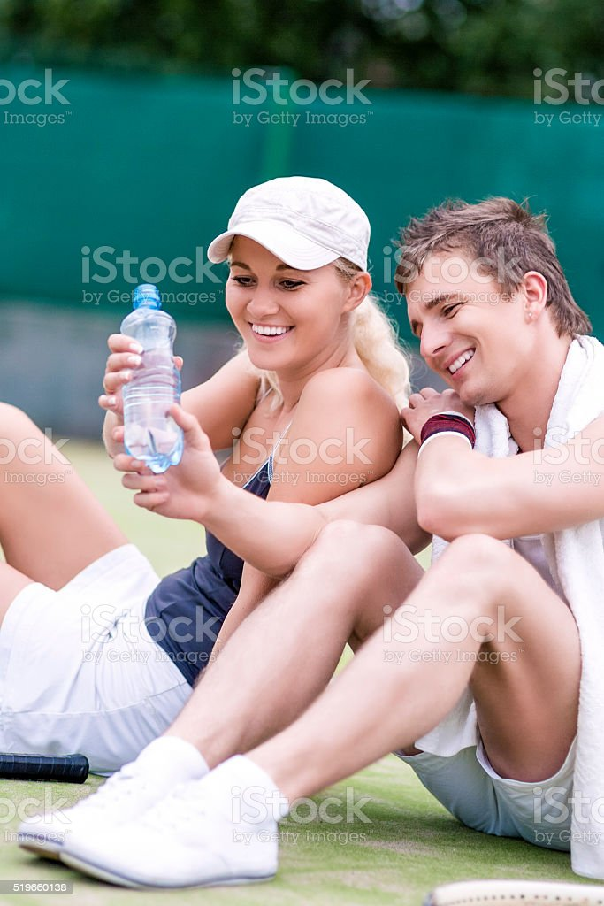 Caucasian Couple In Tennis Gear stock photo