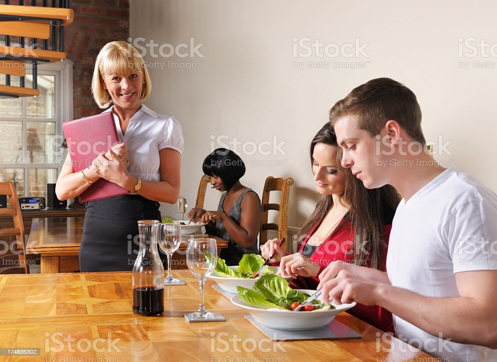 Caucasian Couple Menu Enjoying A Meal Out royalty-free stock photo