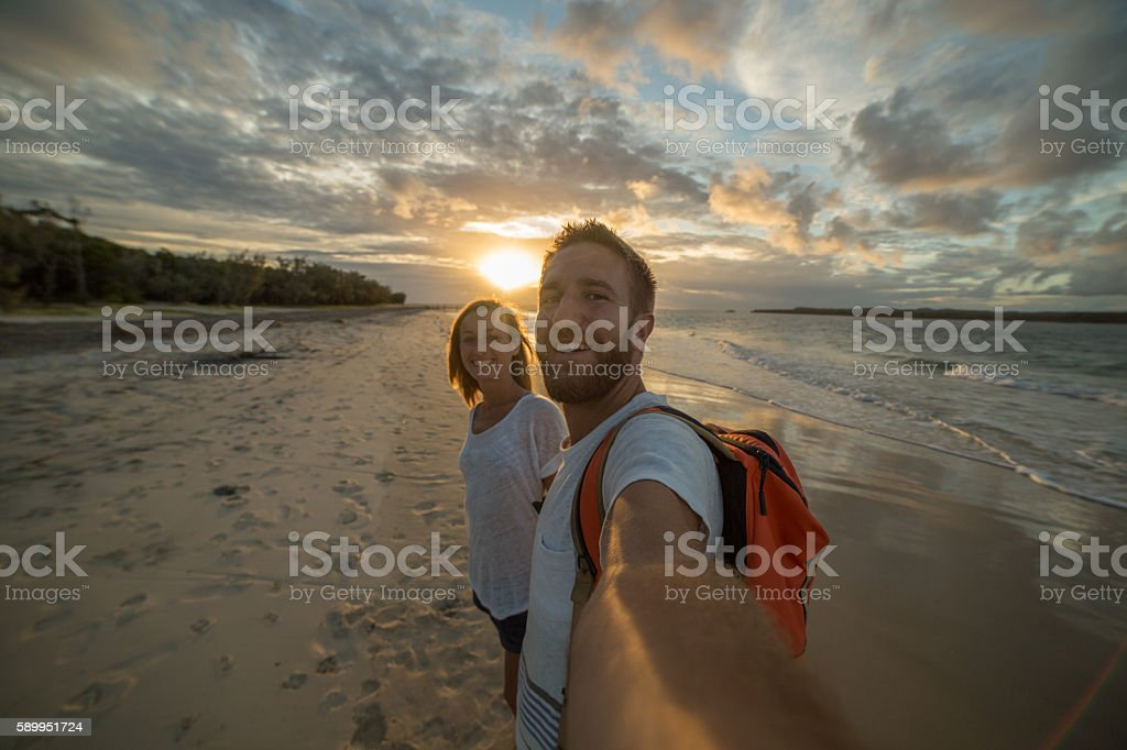 Caucasian couple take selfie portrait on beach at sunset – Foto