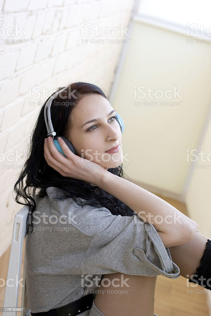 Caucasian dark haired woman with earphones royalty-free stock photo