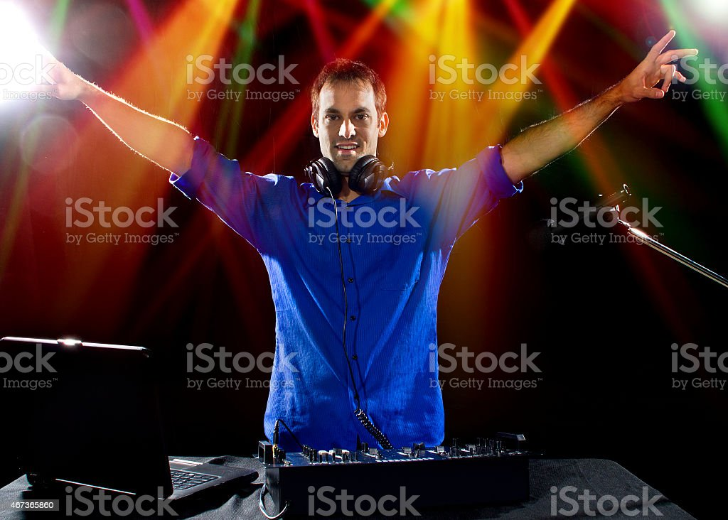 Caucasian DJ Playing Music at a Party in a Nightclub stock photo