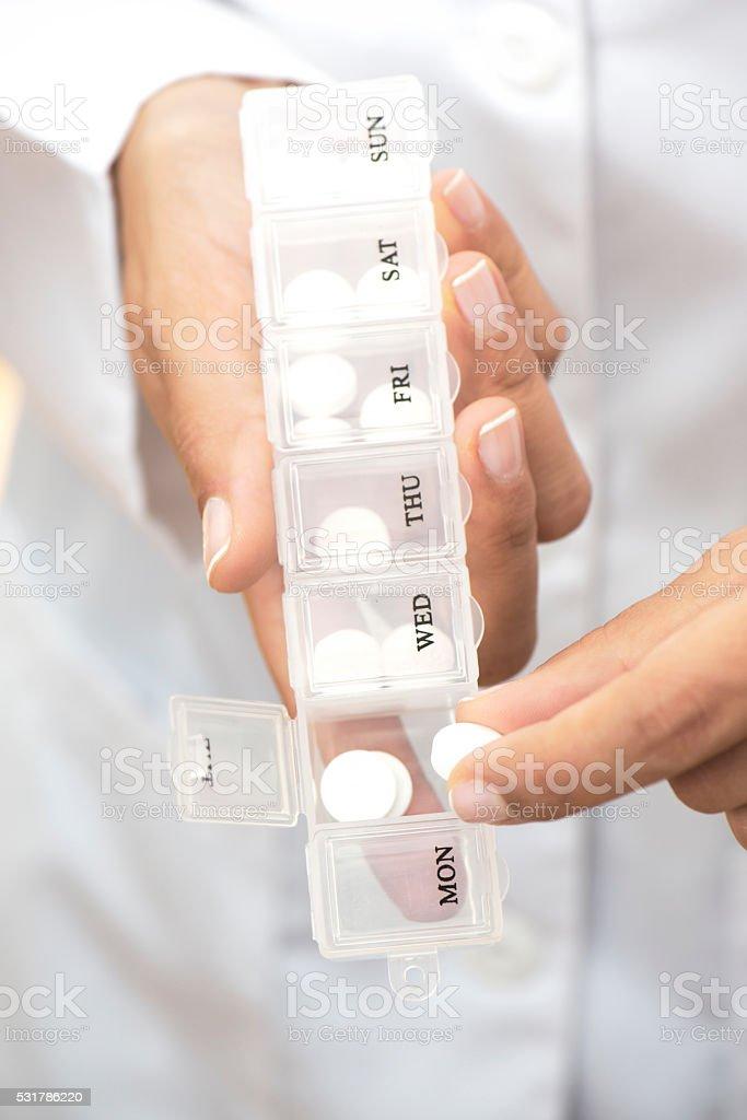 Caucasian Doctor Showing Pill Box stock photo
