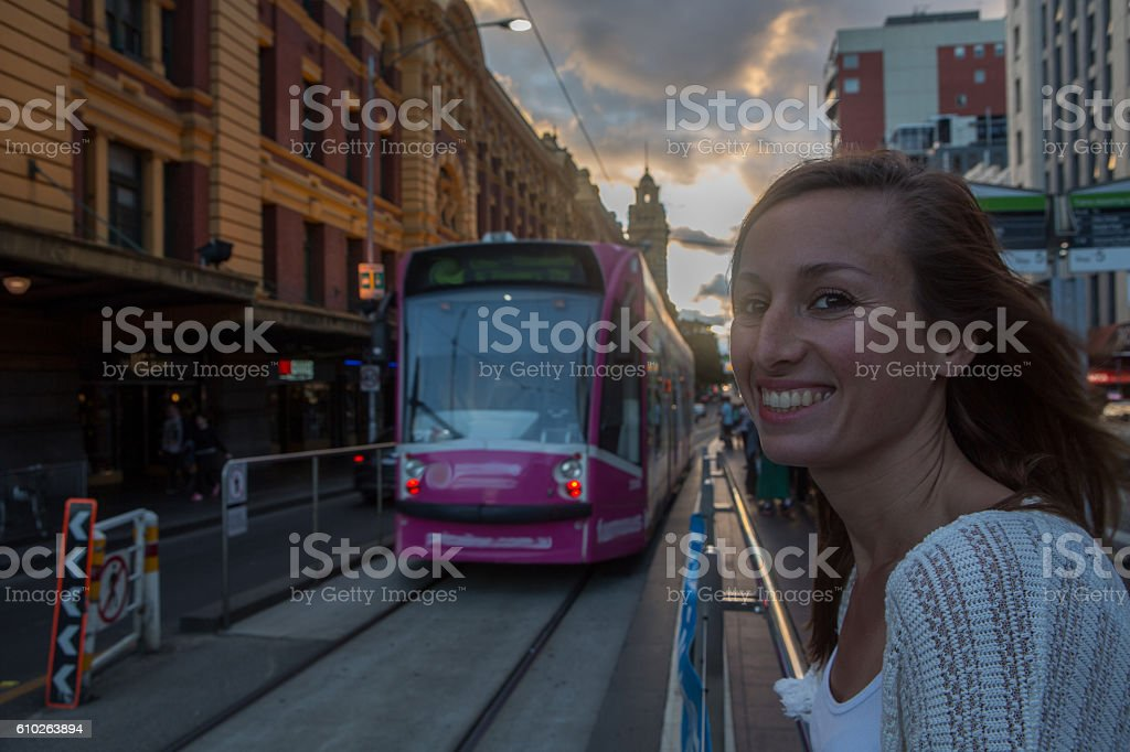 Caucasian female at Flinders Street railway station waiting for tramway stock photo