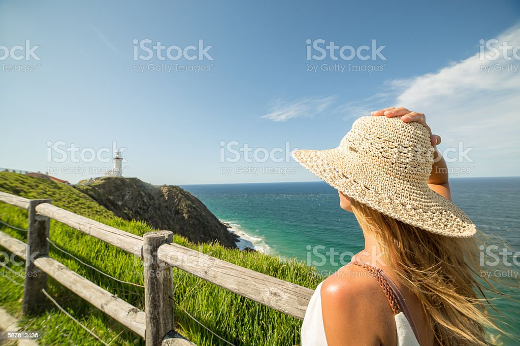 Caucasian female contempling seascape stock photo