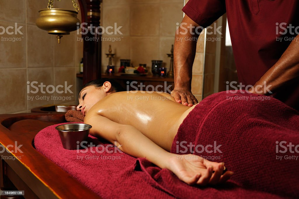 Caucasian Female Enjoying An Ayuverdic Massage stock photo