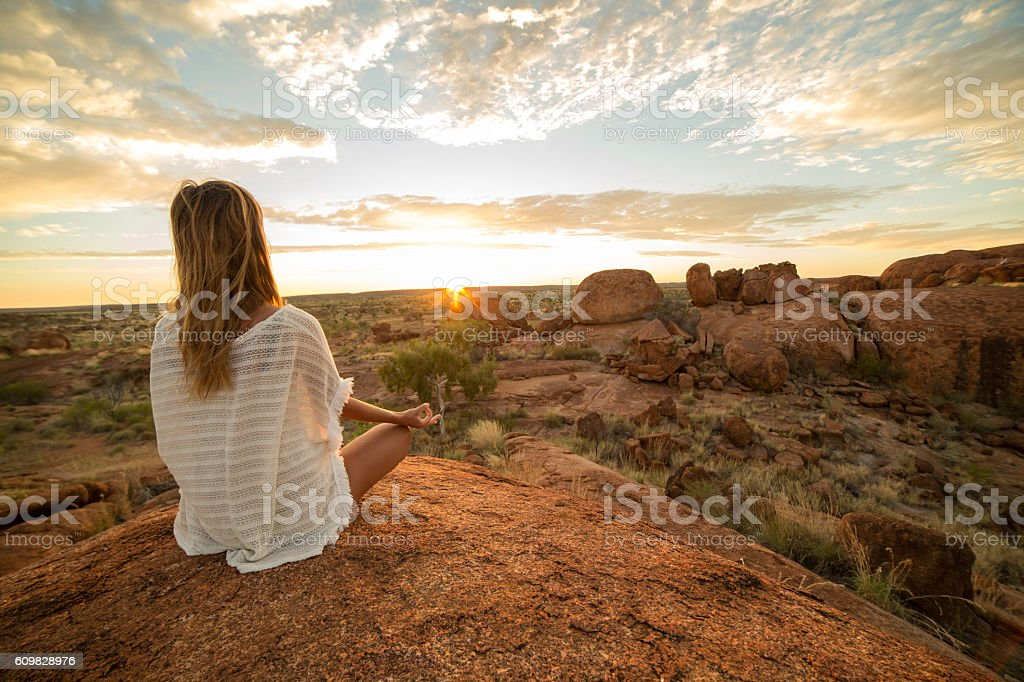 Caucasian female exercising yoga at sunrise stock photo