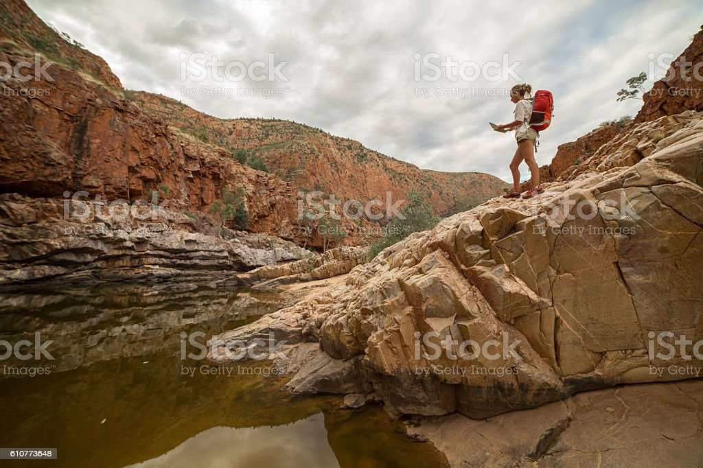 Caucasian female hiking in the Australia's outback reads a map stock photo