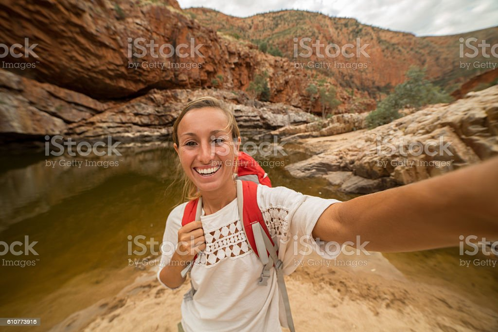 Caucasian female hiking takes a selfie portrait stock photo