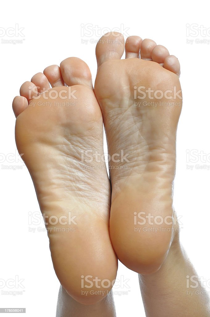 Caucasian female legs, feet, smooth skin and body care concept royalty-free stock photo