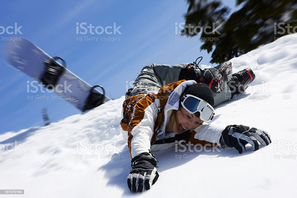 Caucasian Female Snowboarder Wipe Out on Snowy Mountain, Copy Space stock photo