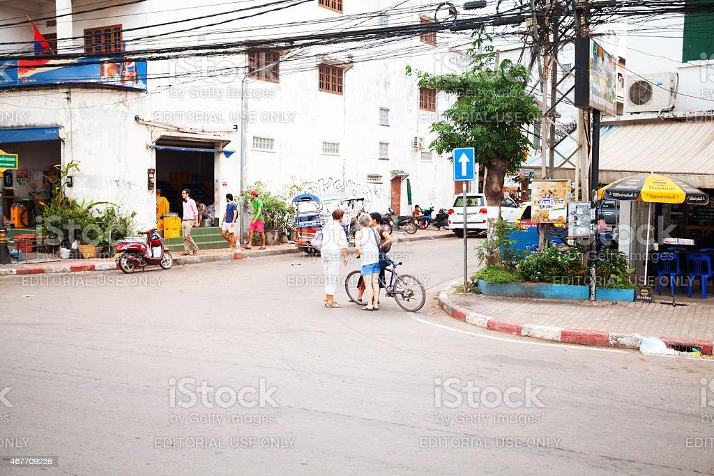 Caucasian female tourists on street Quai Fa Ngum stock photo