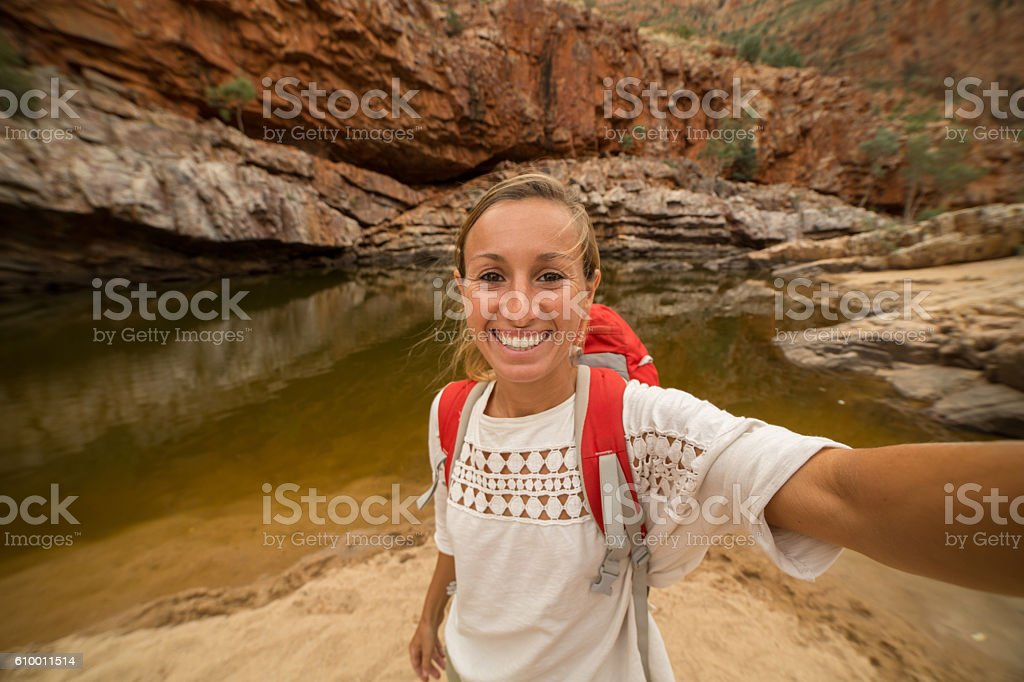 Caucasian female traveling takes a selfie portrait stock photo