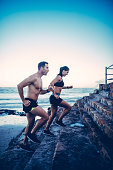 Caucasian fit couple doing running workout outdoor