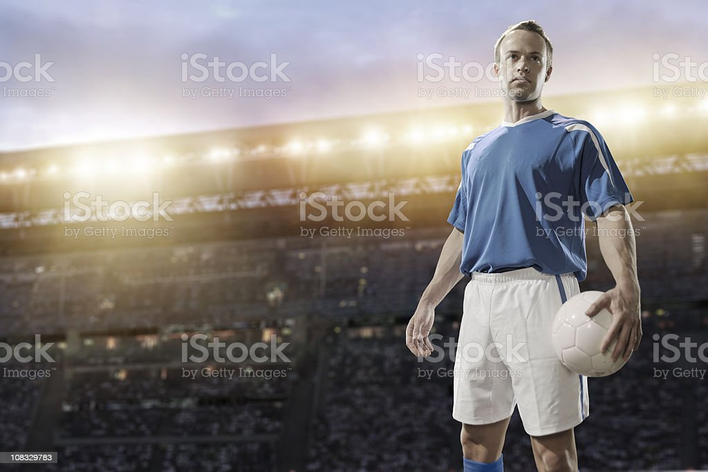 caucasian football player in blue jersey royalty-free stock photo