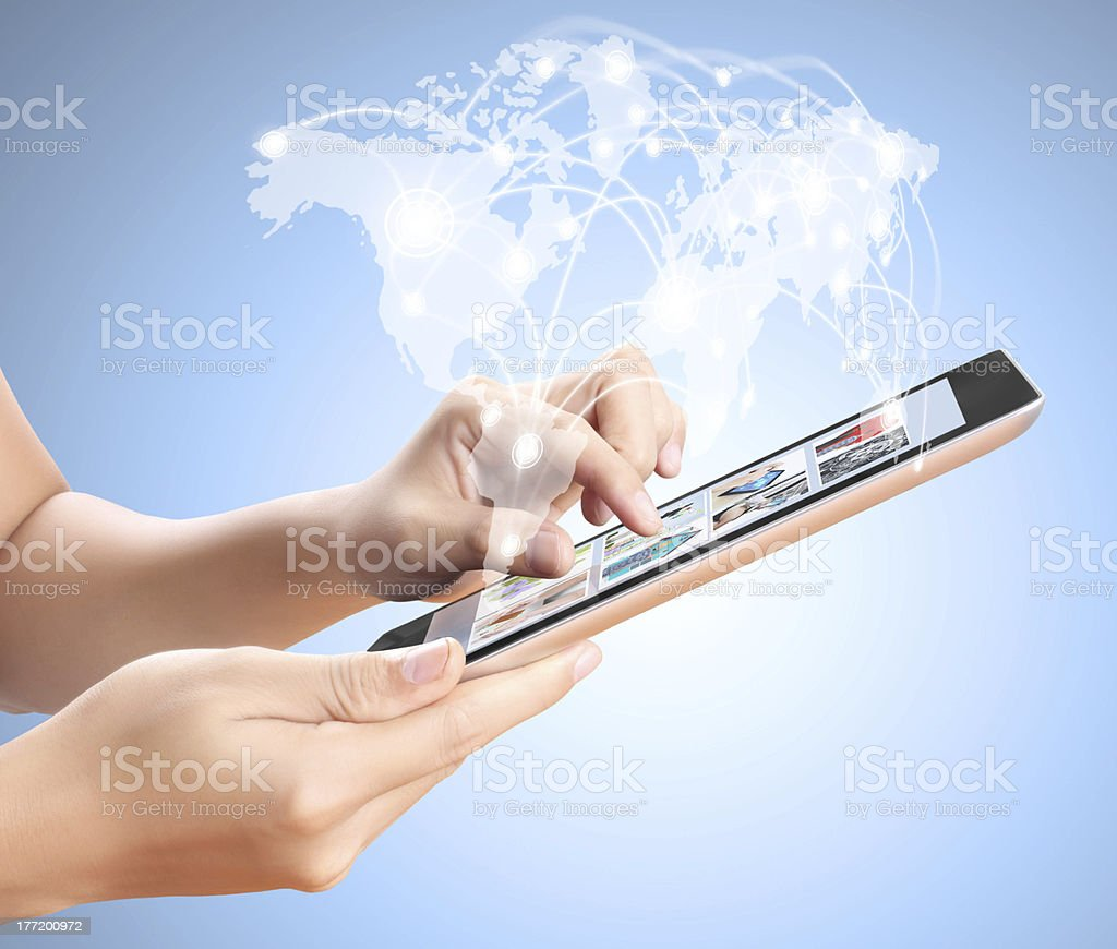 Caucasian hands with touch screen tablet stock photo