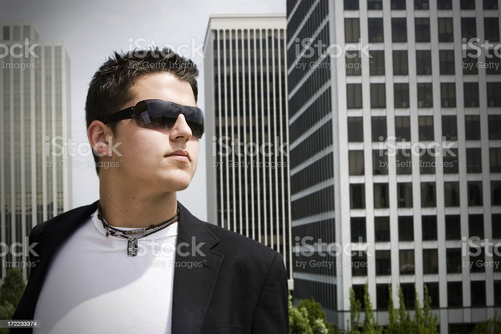 Caucasian Handsome Young Man Fashion Model with Sunglasses, Rooftop, Copyspace royalty-free stock photo