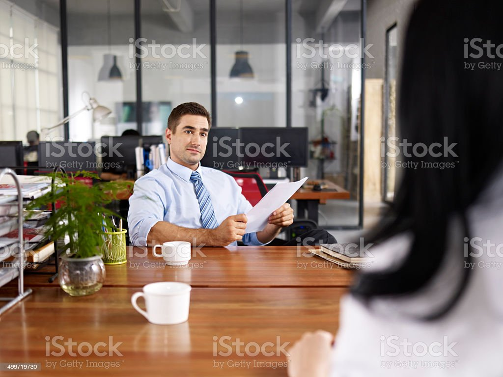 caucasian hr manager conducting an interview stock photo