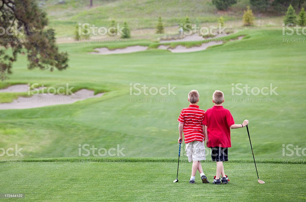 Caucasian Junior Golfers on the Tee Box royalty-free stock photo