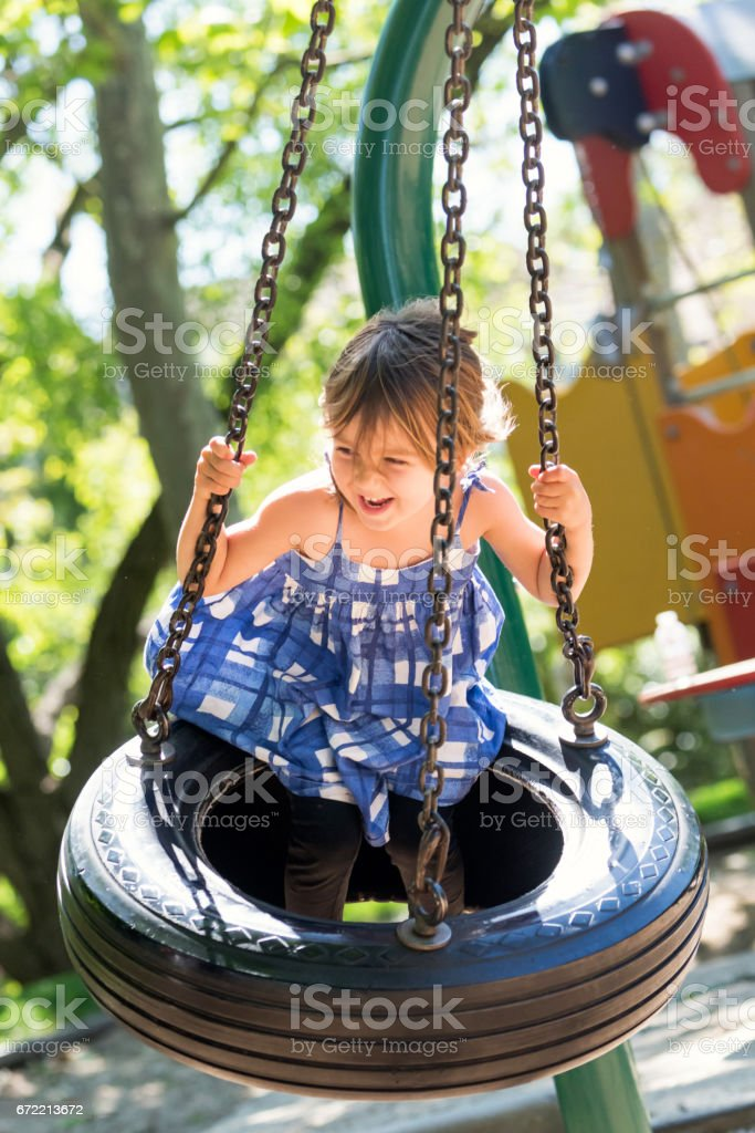 Caucasian Little girl at the park playground stock photo