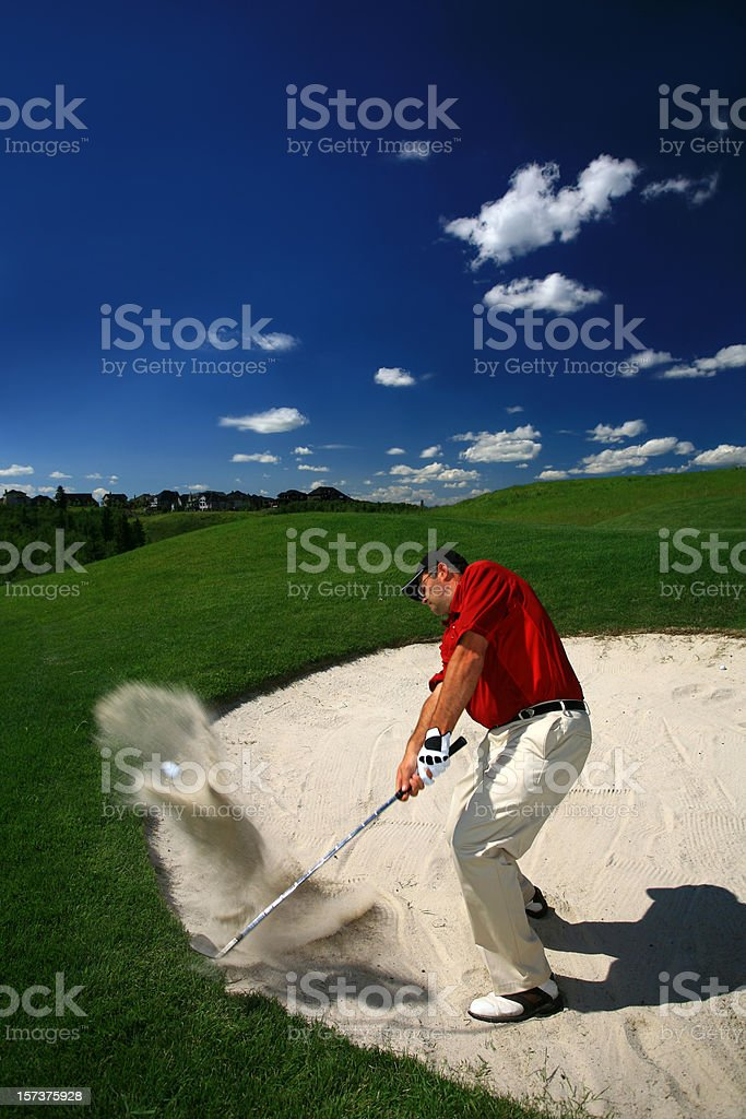 Caucasian Male Goler Hitting Bunker Shot stock photo