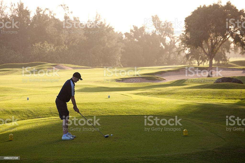 Caucasian Male Golfer Driving Off The Tee stock photo