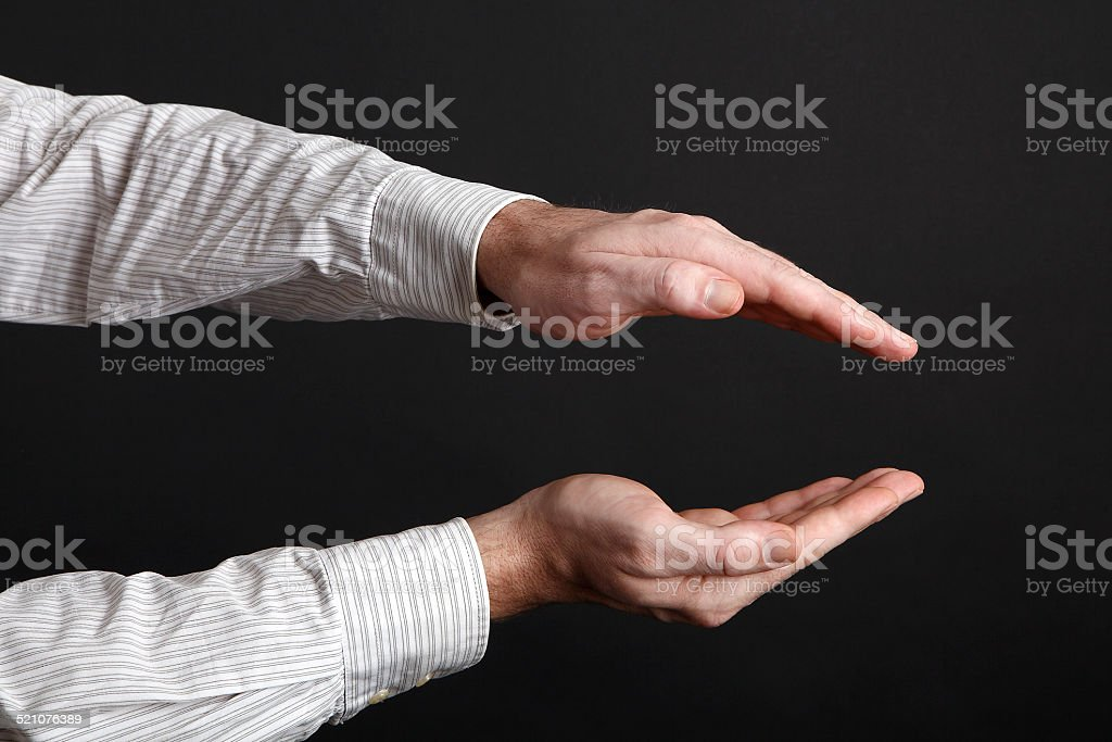Caucasian male hands protect something stock photo