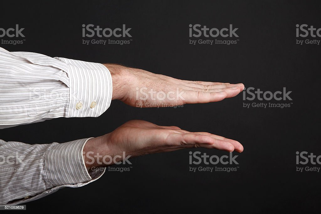 Caucasian male hands squeeze something stock photo