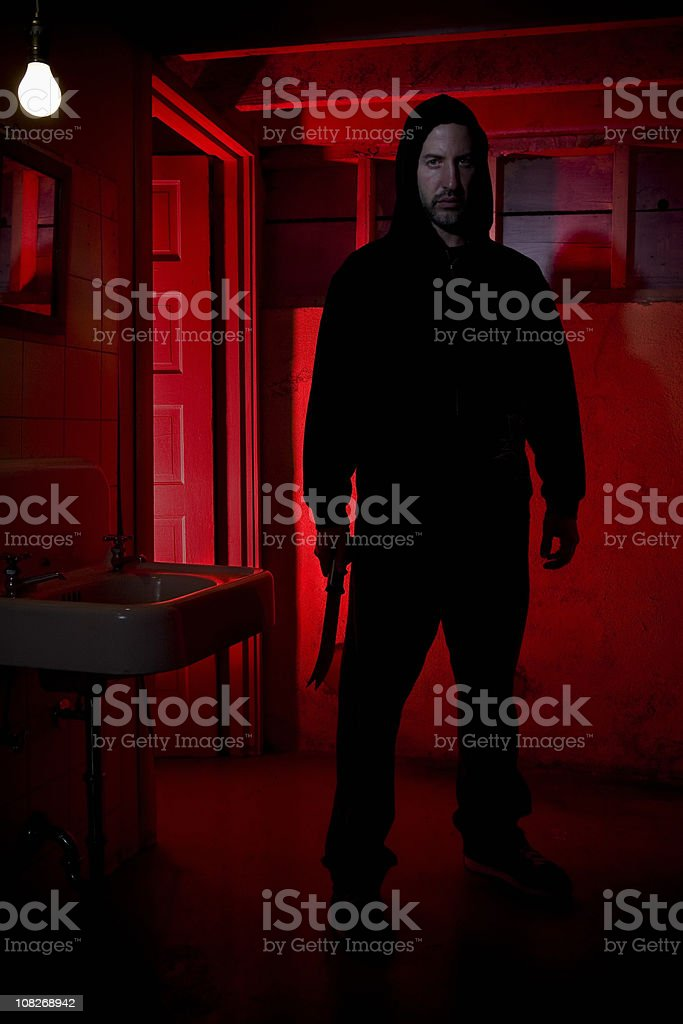 Caucasian Male Intruder Standing with Knife royalty-free stock photo