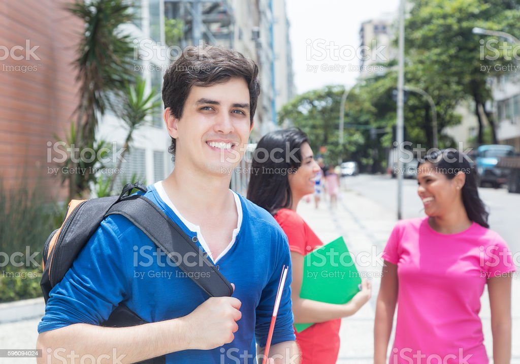 Caucasian male student with friends stock photo