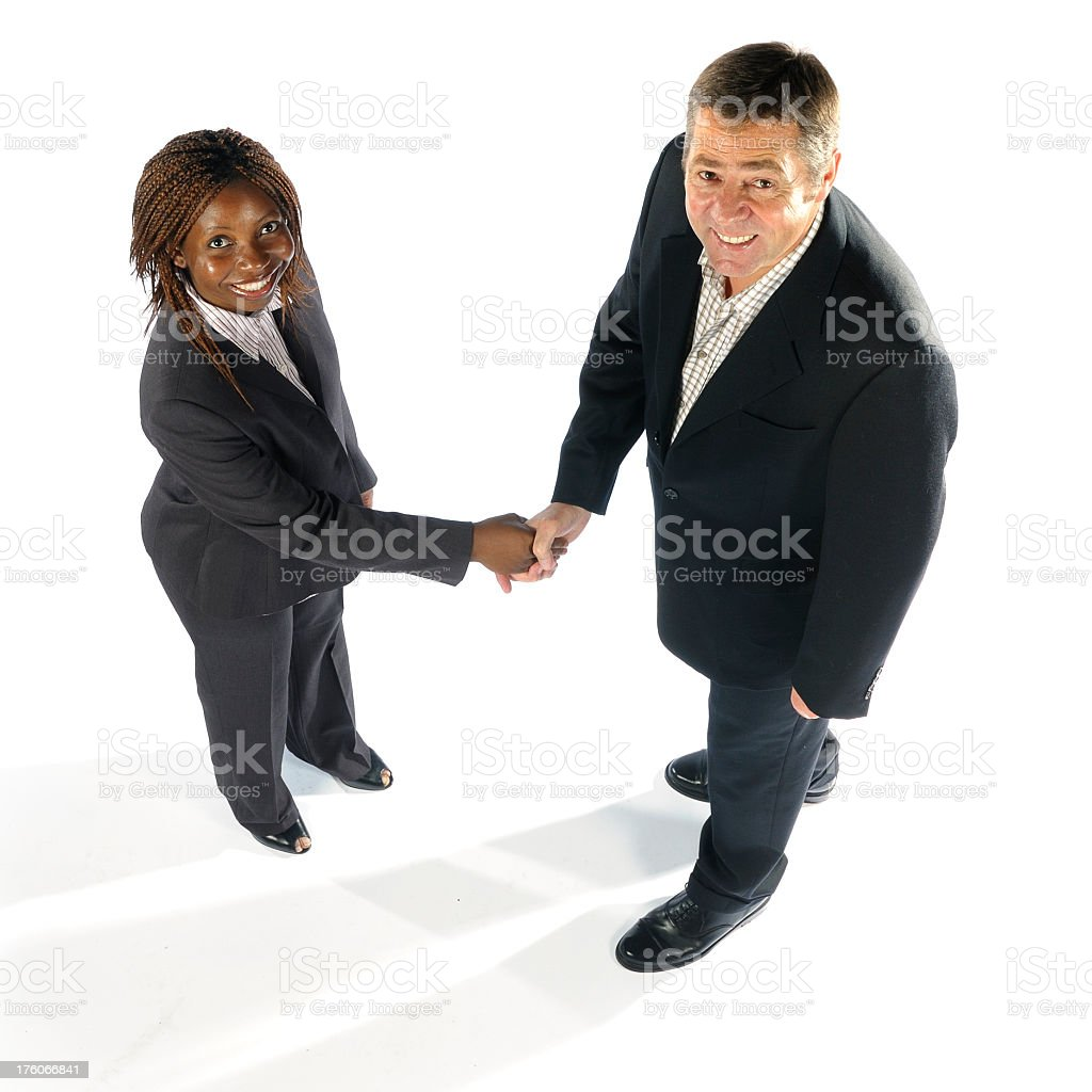 Caucasian Man & African American Woman Shaking Hands -Overhead royalty-free stock photo
