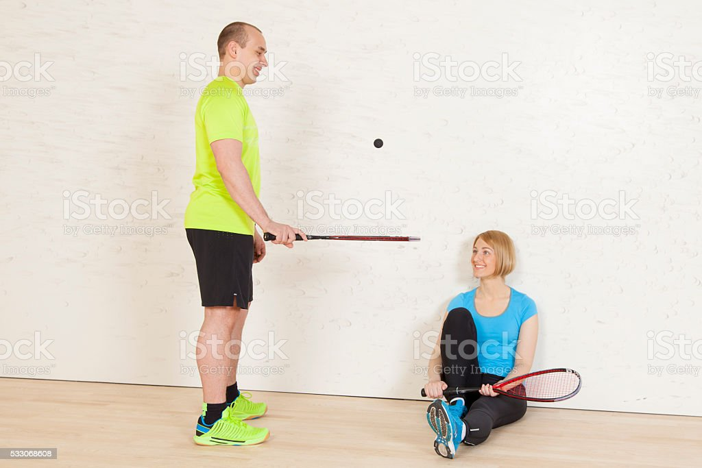 caucasian man and woman on the squash court stock photo