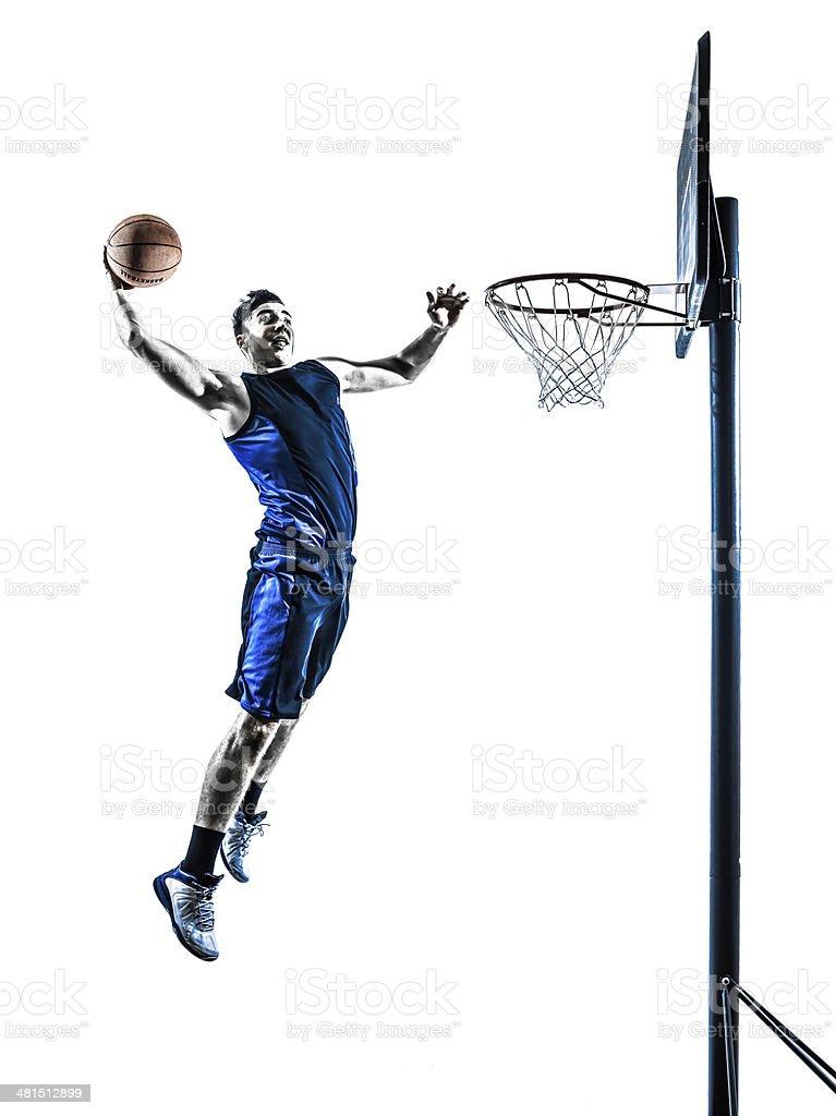 caucasian man basketball player jumping dunking silhouette stock photo