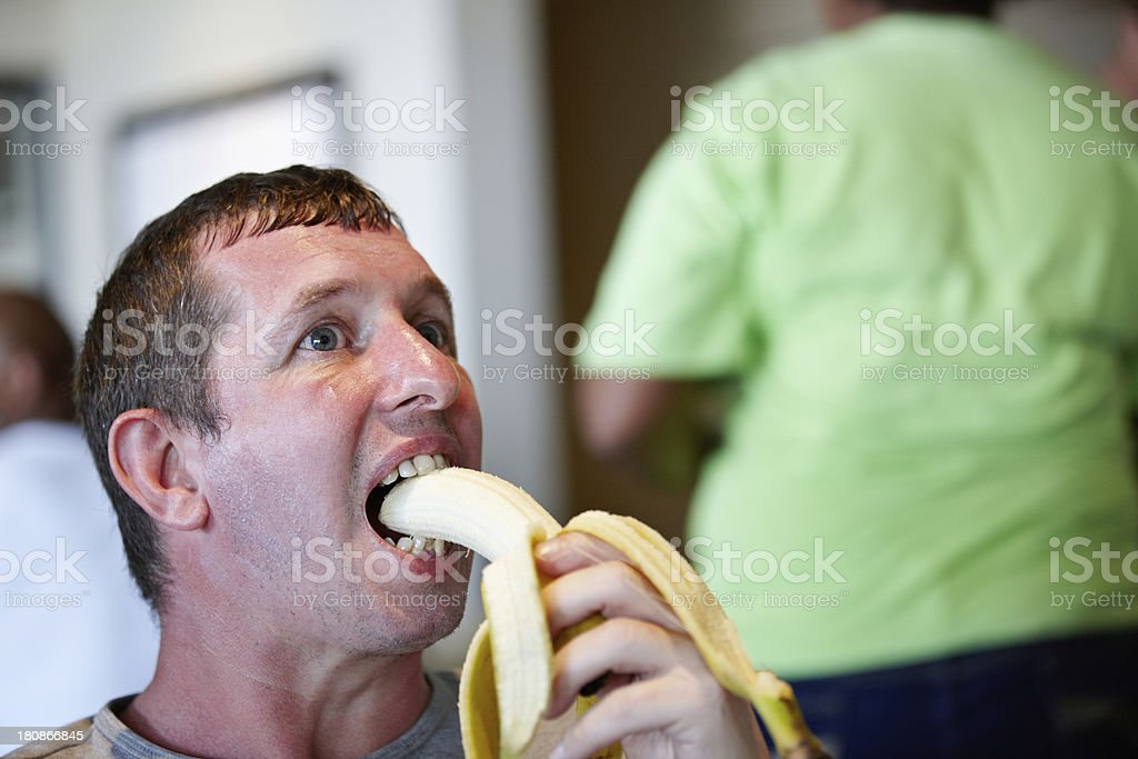 Caucasian man eating banana royalty-free stock photo