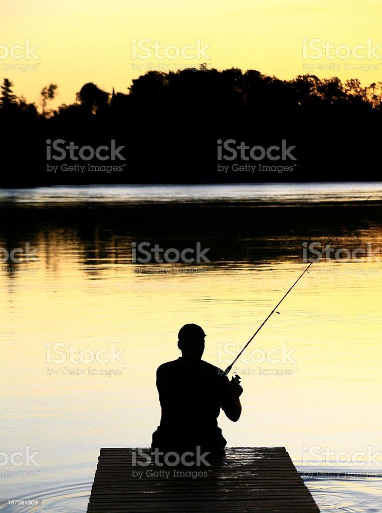 Caucasian Man Fishing Silhouette stock photo