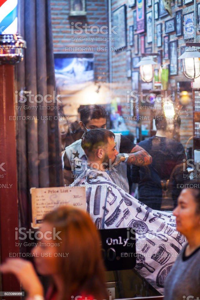 Caucasian man inside of hairdresser salon stock photo