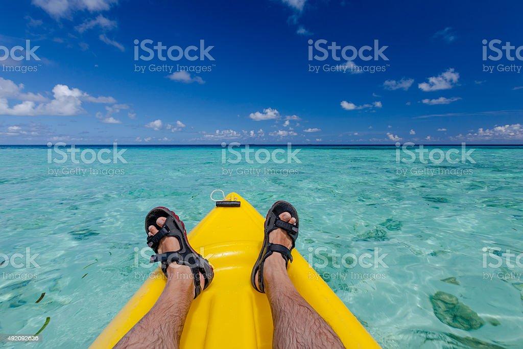 Caucasian man kayaking in sea at Maldives stock photo