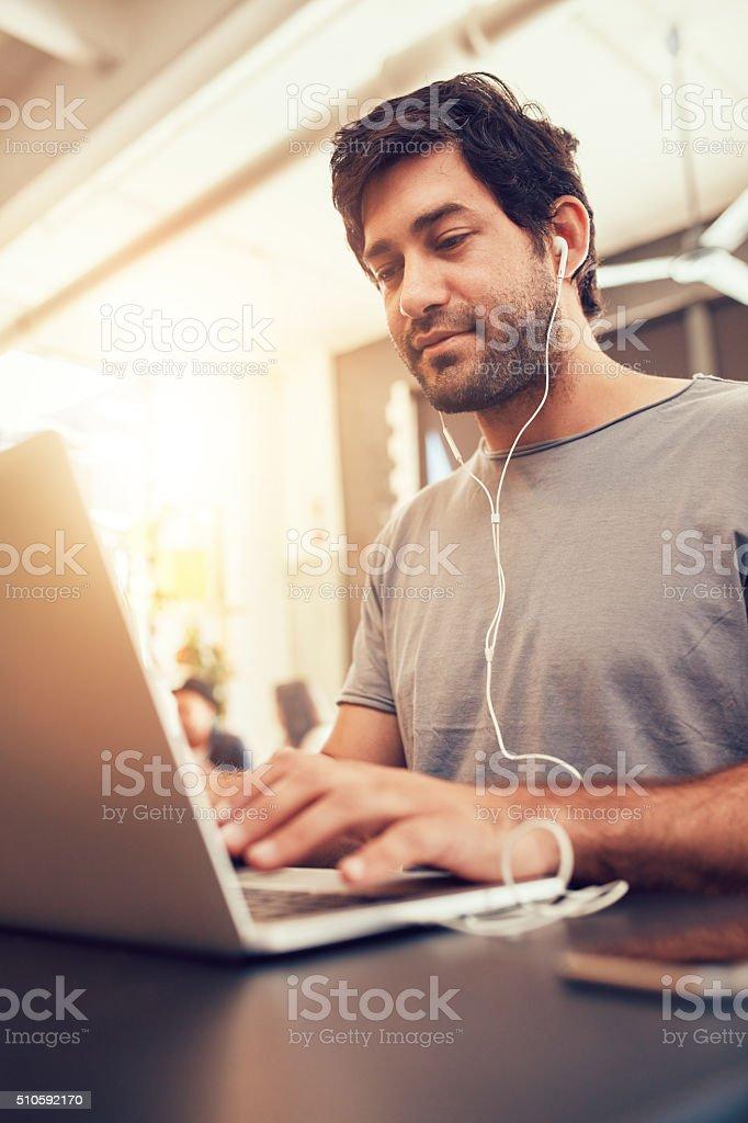 Caucasian man sitting in coffee shop using laptop stock photo