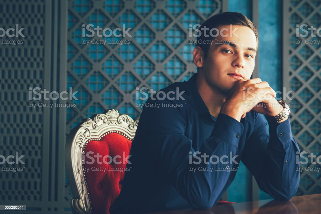 Caucasian Man Sitting in Restaurant stock photo