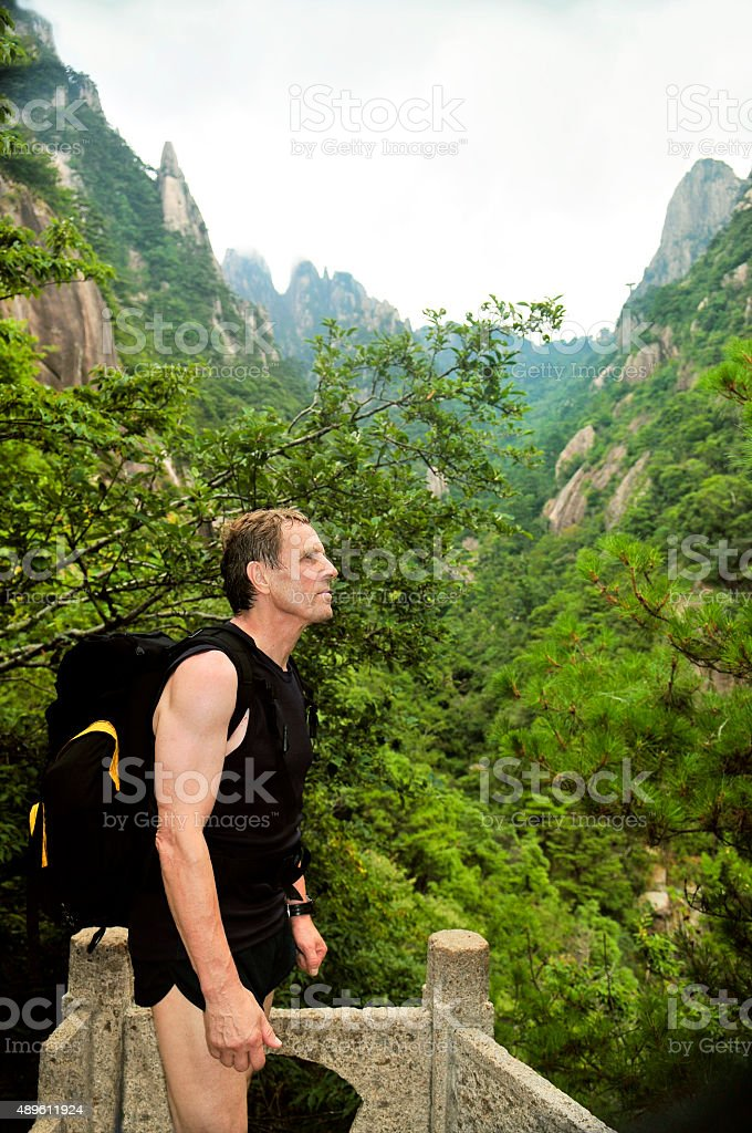Caucasian Man Walking to Huangshan Mountains, Anhui Province, China stock photo
