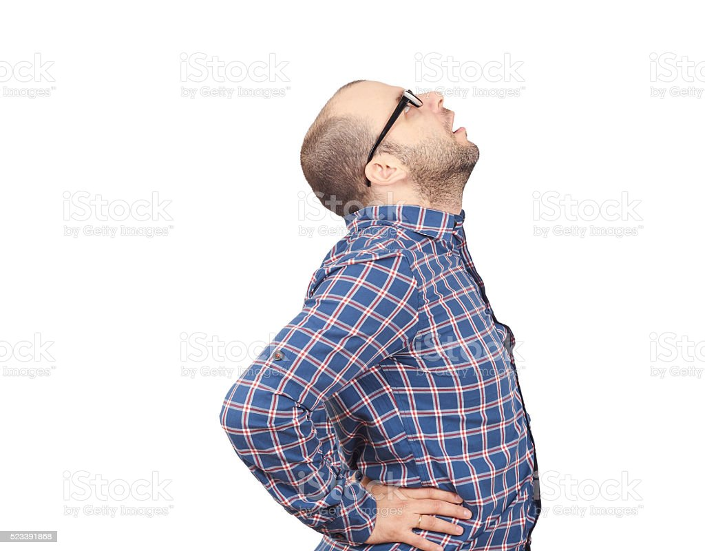 Caucasian man  with intense back pain stock photo