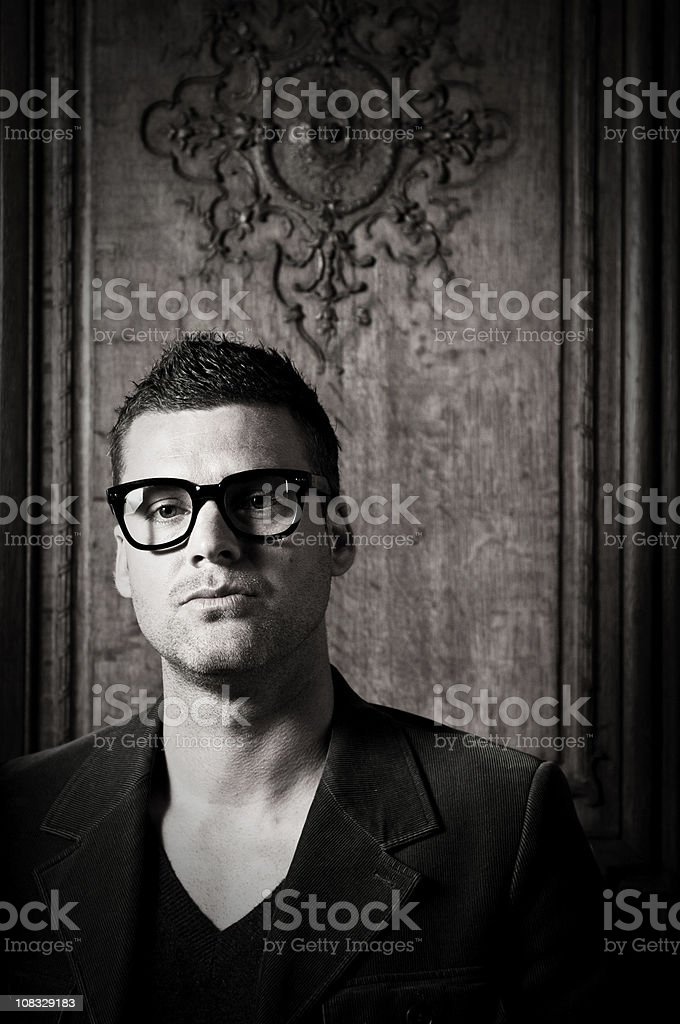 Caucasian man with think rimmed glasses stock photo