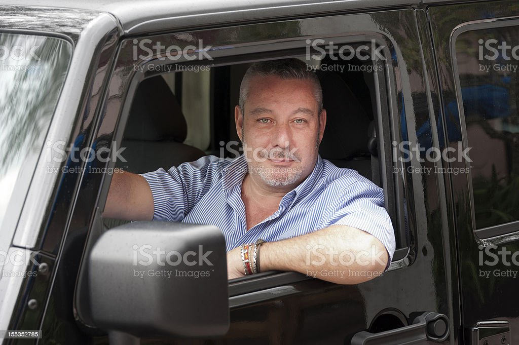 Caucasian mature man driving royalty-free stock photo