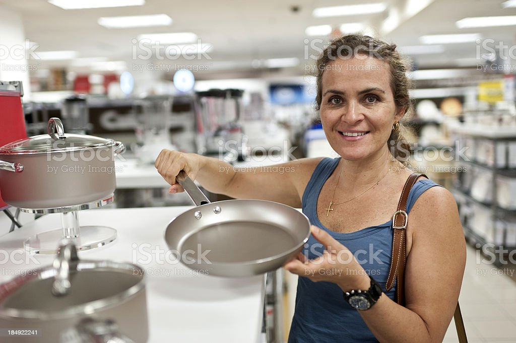 Caucasian mature woman shopping for a pan royalty-free stock photo