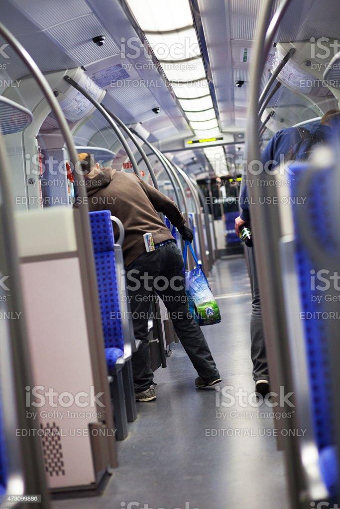 Caucasian men collecting deposit bottles stock photo