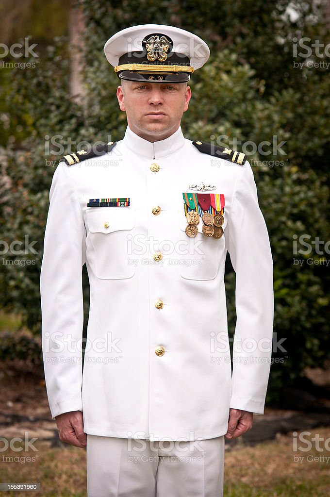 Caucasian Naval Officer Standing at Attention Outside stock photo