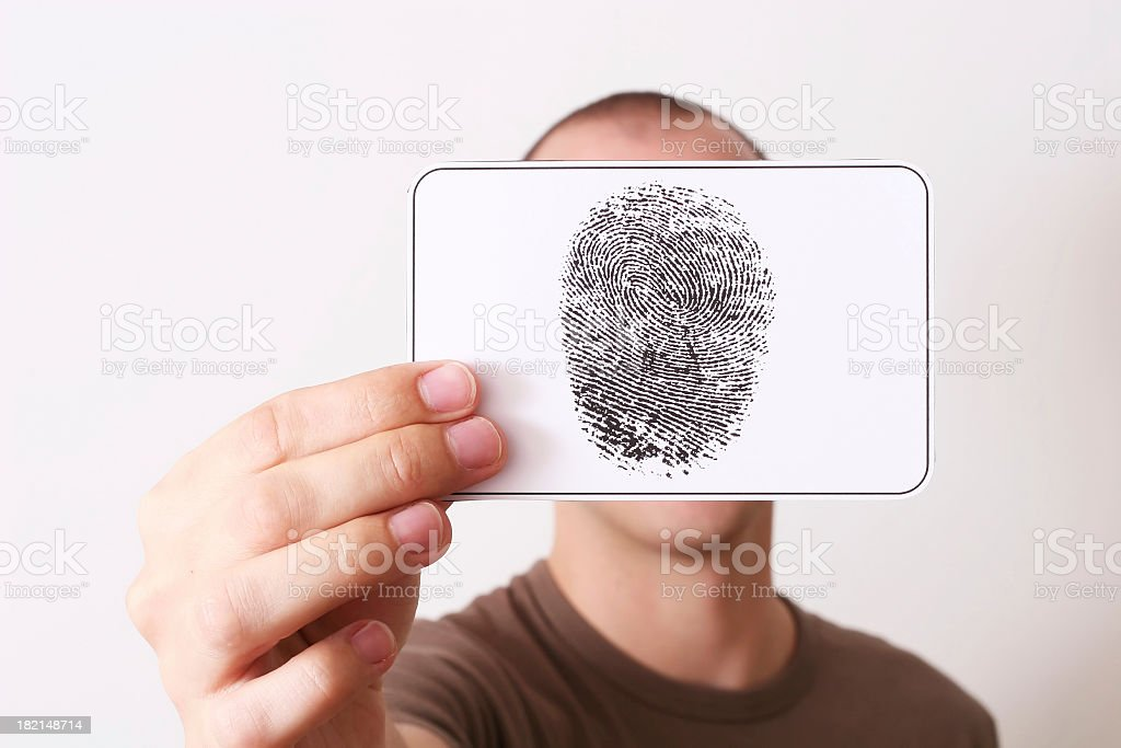 Caucasian person holding up ink fingerprint over face royalty-free stock photo