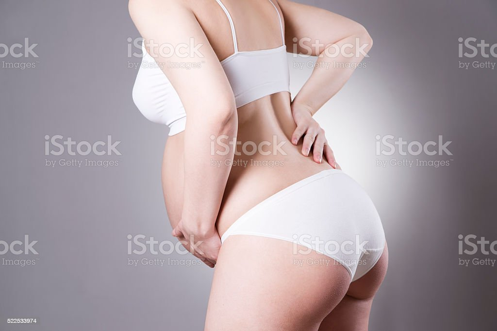 Caucasian pregnant woman in white lingerie with abdominal pain stock photo