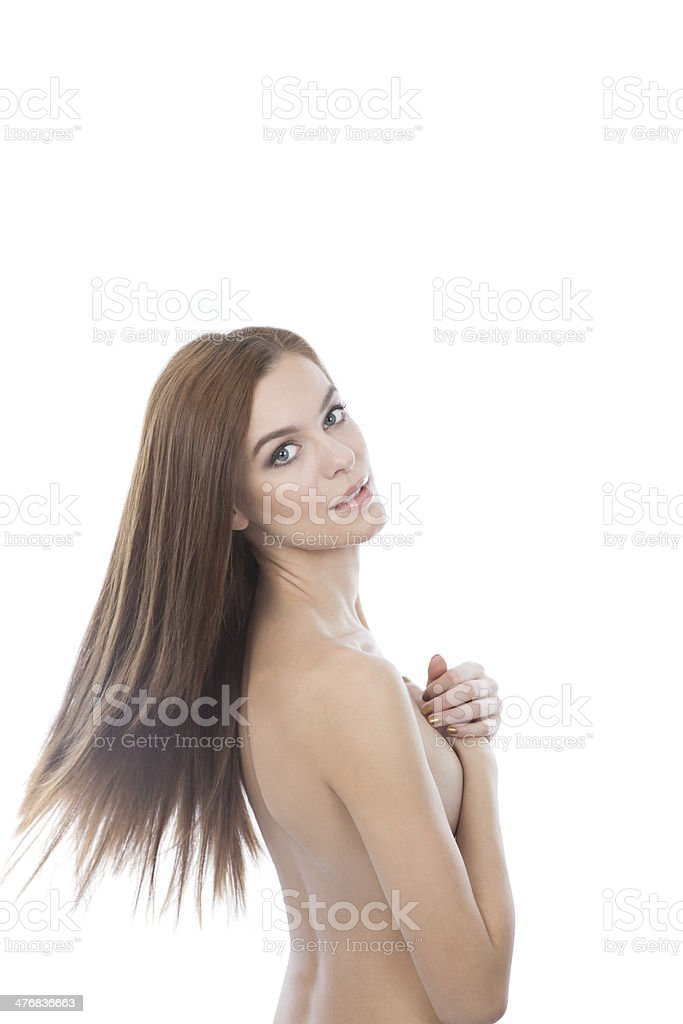 Caucasian red hair woman covering her breats. White background. royalty-free stock photo