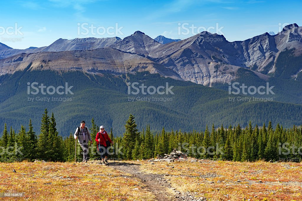 Caucasian senior couple hiking in the mountains stock photo